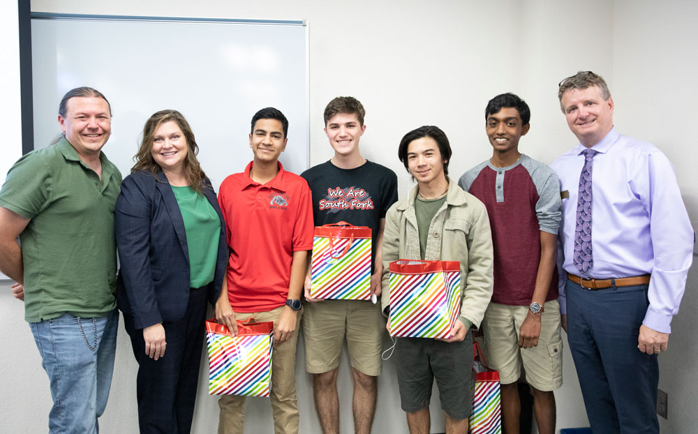 The South Fork Red Team swept the 2019 Math Olympics at IRSC. Pictured from left to right: Chris Bryan; Dr. Heather Belmont, IRSC Vice President of Academic Affairs; Rohan Jakhete; Jeremy Ortmann; Sol Scholl; Varun Lakshmanan; and Dr. Anthony Dribben, IRSC Assistant Dean of Mathematics and Natural Sciences.